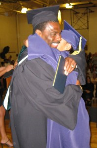 Mr. Simpson congratulating a Charter School student at graduation